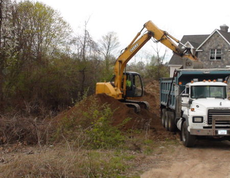 This Is A Photo Of An Excavator Dumping Dirt Into A Dump Truck, Excavation Plus, Monson Ma, Western Ma